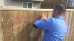 Mannan Hamrasho used a chisel to scrape off the graffiti on Wednesday afternoon.