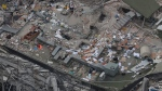 A Red Cross worker stands, top center, on a collapsed building where rescuers continue searching for people trapped inside, in the Roma Norte neighborhood of Mexico City, Wednesday, Sept. 20, 2017.  (AP Photo/Rebecca Blackwell)