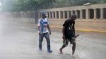 Men wade through a flooded Alemania Avenue as Hurricane Maria reaches the coast of Bavaro, Dominican Republic, Wednesday, Sept. 20, 2017. (AP Photo/Tatiana Fernandez)