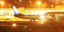 A hijacked Boeing 737 belonging to CanJet sits on the tarmac near the Jamaican resort of Montego Bay, Monday, April 20, 2009. (AP / Patricia Roxborough, Jamaica Observer)