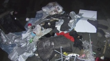 Club owner says garbage, feces thrown onto roof
