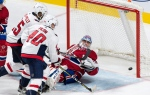 Washington Capitals' Devante Smith-Pelly, top left, scores past Montreal Canadiens goaltender Charles Lindgren as Capitols' Garrett Pilon looks on during third period NHL pre-season hockey action Wednesday, September 20, 2017 in Montreal. THE CANADIAN PRESS/Paul