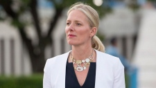Minister of Environment and Climate Change Catherine McKenna makes her way to speak with media at the United Nations Headquarters in New York City, Wednesday September 20, 2017. THE CANADIAN PRESS/Adrian Wyld