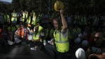 Miners shout slogans outside Development Ministry in Athens on Thursday, Sept. 21, 2017. (AP / Petros Giannakouris)