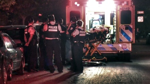 Police and paramedics on Duvernay St. help a man they believed had been attacked. It turns out he had a medical emergency possibly related to a pre-existing condition. (CTV Montreal/Cosmo Santamaria)