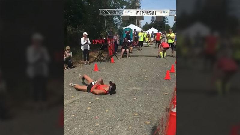 Runner Devon Bieling rolling over the finish line