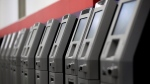 In this Wednesday, Aug. 30, 2017, photo, automated teller machines are lined up during the manufacturing process at Diebold Nixdorf in Greensboro, N.C. (AP Photo/Gerry Broome)