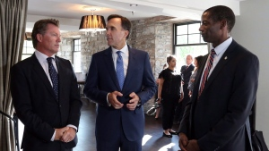 Finance Minister Bill Morneau (centre) chats with Gatineau businessman Mike Clemann (left) and Greg Fergus (right) Liberal M.P. for Hull Aylmer in Gatineau, on Wednesday, September 20, 2017. (Fred Chartrand / THE CANADIAN PRESS)