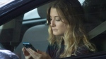In this Wednesday, June 22, 2016, file photo, a driver uses her mobile phone while sitting in traffic in Sacramento, Calif. (Rich Pedroncelli/AP Photo)