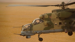 In this Friday, Sept. 15, 2017 file photo, Russian military helicopter flies over a desert in Deir es-Zor province, Syria. (AP Photo, File)