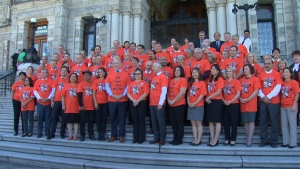 B.C. Premier John Horgan and other politicians wore orange shirts during a ceremony at the legislature to remember the thousands of Indigenous children forced to go to Canadian residential schools. Sept. 21, 2017. (CTV Vancouver Island)