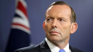 In this Sept. 19, 2014, file photo, former Australian Prime Minister Tony Abbott speaks during a press conference, in Sydney. (AP Photo / Rick Rycroft, File)