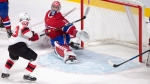 New Jersey Devils left wing Jesper Bratt (63) scores against Montreal Canadiens goalie Carey Price (31) during third period NHL pre-season hockey action Thursday, September 21, 2017 in Montreal. THE CANADIAN PRESS/Ryan Remiorz