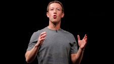 FILE - In this Sunday, Feb. 21, 2016, file photo, Facebook CEO Mark Zuckerberg speaks during the Samsung Galaxy Unpacked 2016 event on the eve of this week's Mobile World Congress wireless show, in Barcelona, Spain. On Thursday, Sept. 21, 2017, Zuckerberg said that Facebook will provide the contents of 3,000 ads bought by a Russian agency to congressional investigators. The move comes as the company has faced growing pressure from members of Congress to release the content of the ads. Facebook had already released the ads to federal authorities investigating Russian interference in the 2016 U.S. presidential election. (AP Photo/Manu Fernandez, File)