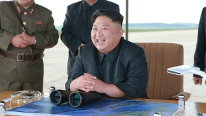 North Korean leader Kim Jong Un, centre, attends what was said to be the test launch of an intermediate range Hwasong-12 missile at an undisclosed location in North Korea in this image released on Saturday, Sept. 16, 2017. (Korean Central News Agency / Korea News Service)