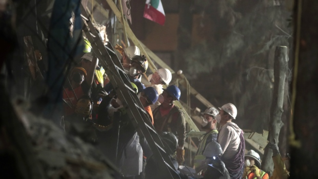 Personnel work in rescue operations in the rubble of a building felled by a 7.1 magnitude earthquake, in the Ciudad Jardin neighborhood of Mexico City on Thursday, Sept. 21, 2017. (AP / Eduardo Verdugo)
