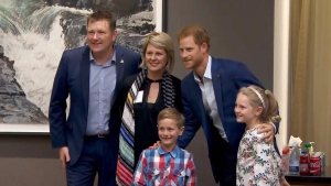 Prince Harry meets with a family after arriving in Toronto for the Invictus Games, Friday, Sept. 22, 2017.