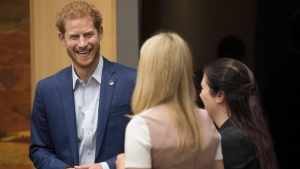 Prince Harry talks with Bronwen Evans and Leah Cuffe, right, during a reception before the True Patriot Love Symposium, in Toronto on Friday, September 22, 2017. THE CANADIAN PRESS/Chris Young
