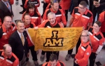 Members of Team Canada hold a flag signed by Members of Parliament as they pose for a photo with Minister of Veterans Affairs Seamus O'Regan during a welcoming ceremony at Rideau Hall for competitors at the 2017 Toronto Invictus Games, in Ottawa on Wednesday, Sept. 20, 2017. THE CANADIAN PRESS/Justin Tang