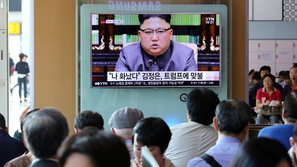 People watch a TV screen showing an image of North Korean leader Kim Jong Un delivering a statement in response to U.S. President Donald Trump's speech to the United Nations, in Pyongyang, North Korea, at the Seoul Railway Station in Seoul, South Korea, Friday, Sept. 22, 2017. (AP / Ahn Young-joon)