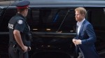 Prince Harry is greeted by a Toronto Police Service officer as he arrives to a reception before the True Patriot Love Symposium, in Toronto on Friday, September 22, 2017. (THE CANADIAN PRESS/Chris Young)