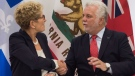 Ontario Premier Kathleen Wynne, left, and Quebec Premier Philippe Couillard shake hands after signing an agreement on climate change with California, in Quebec City on Friday, Sept. 22, 2017. (THE CANADIAN PRESS/Jacques Boissinot)