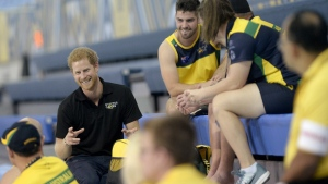 Prince Harry chats with athletes from Australia in Toronto on Sept. 22, 2017. (Nathan Denette / THE CANADIAN PRESS)