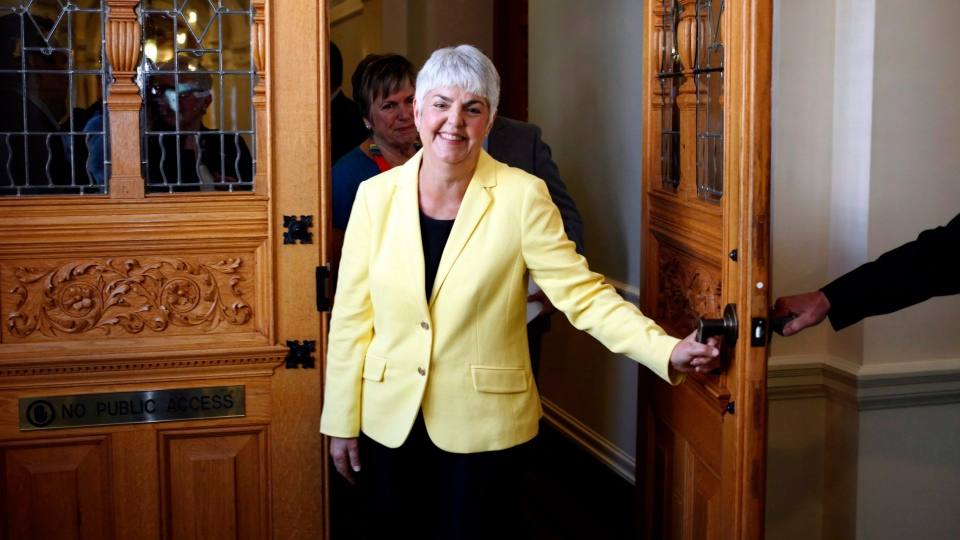 B.C. Finance Minister Carole James leaves the legislative assembly after delivering the budget from the legislative assembly at Legislature in Victoria, B.C., on Monday, September 11, 2017. (THE CANADIAN PRESS/Chad Hipolito)
