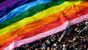 Participants carry a rainbow flag as they march during the annual Gay Pride Parade in Sao Paulo, Brazil, Sunday, June 18, 2017. (AP Photo/Nelson Antoine)