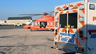 Ornge and Peel Paramedics are seen attending to a female pedestrian struck in Mississauga. (Peel Paramedics)