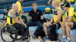 Prince Harry chats with athletes from Australia during swim training in the lead-up to the Invictus Games, in Toronto on Friday, Sept. 22, 2017. THE CANADIAN PRESS/Nathan Denette