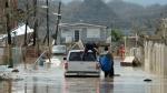 Residents evacuate after the passing of Hurricane Maria, in Toa Baja, Puerto Rico, Friday, September 22, 2017. (AP Photo / Carlos Giusti)