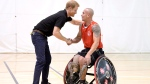 Prince Harry, left, meets an athlete from the Denmark wheelchair basketball team during training in the lead-up to the Invictus Games, in Toronto on Friday, Sept. 22, 2017. THE CANADIAN PRESS/Nathan Denette
