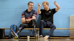 Prince Harry, right, speaks to an athlete from the volleyball team from the United Kingdom during training in the lead-up to the Invictus Games, in Toronto on Friday, Sept. 22, 2017. (Nathan Denette/THE CANADIAN PRESS)