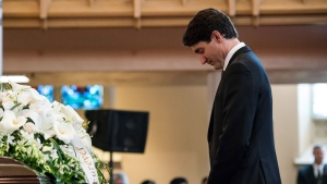 Prime Minister Justin Trudeau pays respects during a funeral service held for former Liberal MP Arnold Chan in Toronto on Saturday, September 23, 2017. THE CANADIAN PRESS/Christopher Katsarov