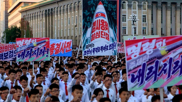 Hundreds of thousands of North Koreans gathered at Kim Il Sung Square to attend a mass rally against America on Saturday Sept. 23, 2017, in Pyongyang, North Korea, a day after the country's leader issued a rare statement attacking Donald Trump. (AP Photo/Jon Chol Jin)