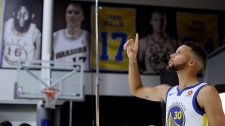 Golden State Warriors' Stephen Curry poses for photos during NBA basketball team media day on Sept. 22. 2017, in Oakland, Calif. (AP / Marcio Jose Sanchez)