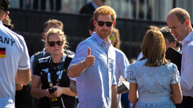 Prince Harry gives a thumbs up to the crowd after riding shotgun in a car with a member of team Germany at the Jaguar Land Rover Challenge at the Invictus Games in Toronto on Saturday, September 23, 2017. THE CANADIAN PRESS/Chris Donovan