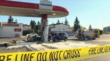 A damaged SUV at the Petro-Canada station on 36 St SE following a fiery crash at the pumps