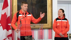 Team Canada co-captain Major Simon Mailloux speaks during a welcoming ceremony at Rideau Hall for athletes competing at the 2017 Toronto Invictus Games, as co-captain MCpl (Ret'd) Natacha Dupuis looks on, in Ottawa on Wednesday, Sept. 20, 2017. (THE CANADIAN PRESS/Justin Tang)