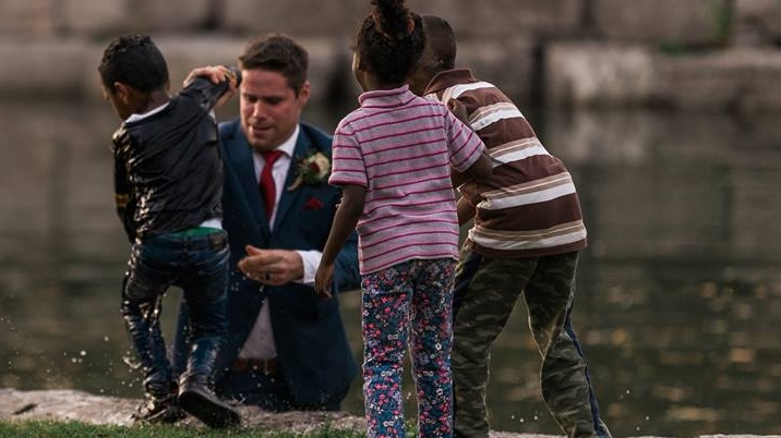 A groom pulls a young boy from the water in Victoria Park in Kitchener on Friday, Sept. 22, 2017 (Photo courtesy of Darren Hatt/Hatt Photograph)
