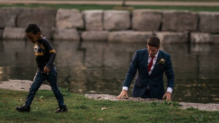 A young boy appears fine after being pulled from the water in Victoria Park in Kitchener on Friday, Sept. 22, 2017 (Photo courtesy of Darren Hatt/Hatt Photograph)