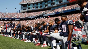 Several New England Patriots players kneel during the national anthem before an NFL football game against the Houston Texans, Sunday, Sept. 24, 2017, in Foxborough, Mass. (AP / Michael Dwyer)