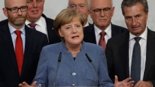 German Chancellor Angela Merkel gives a statement