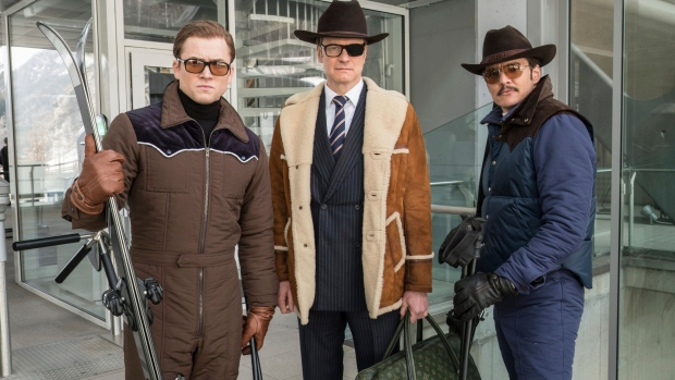 """FILE - This file image released by Twentieth Century Fox shows, from left, Taron Egerton, Colin Firth, and Pedro Pascal in """"Kingsman: The Golden Circle."""" (Giles Keyte/Twentieth Century Fox via AP, File)"""