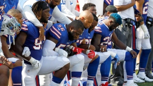 Buffalo Bills players kneel during the national anthem prior to an NFL football game against the Denver Broncos, Sunday, Sept. 24, 2017, in Orchard Park, N.Y. (AP Photo/Jeffrey T. Barnes)