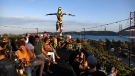 People enjoy the sunset at the rooftop of the Rio Maravilha bar and restaurant at Lx Factory in Lisbon. (PATRICIA DE MELO MOREIRA / AFP)