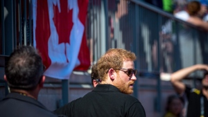Prince Harry enters York Lions Stadium to award medals for the women's 100 metre dash at the Invictus Games in Toronto on Sunday, Sept. 24, 2017. THE CANADIAN PRESS / Chris Donovan
