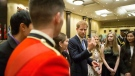 Prince Harry talks to recipients of the Gold level Duke of Edinburgh International Awards during a ceremony in Toronto on Sunday, September 24, 2017. (THE CANADIAN PRESS/Chris Young)