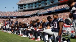 Several New England Patriots players kneelduring the national anthem before an NFL football game against the Houston Texans, Sunday, Sept. 24, 2017, in Foxborough, Mass. (AP Photo/Michael Dwyer)